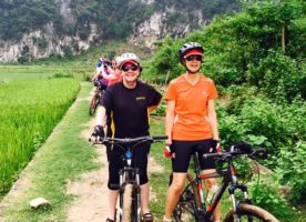 Lesley-Anne Houghton and Michele Hoskins mountain biking in the rice fields of Mai Chau